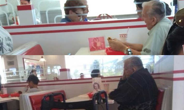 man eats lunch with picture of dead wife