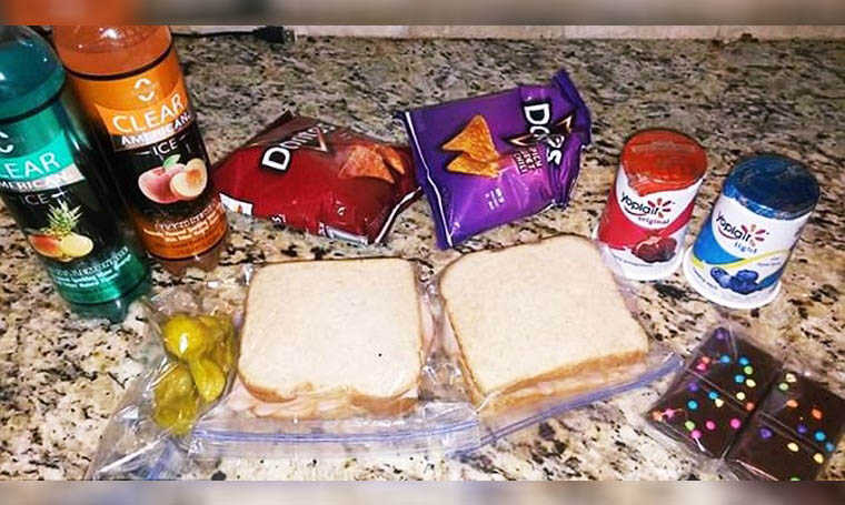 mother packs two school lunches